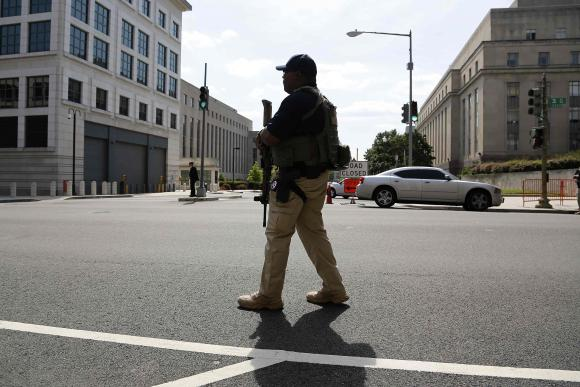 A U.S. Federal Marshal secures the streets outside the U.S. federal court in Washington.