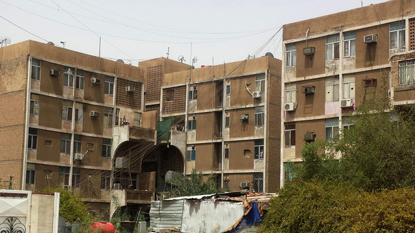 Apartment blocks in Baghdad's Zayouna district where gunmen slaughtered twenty-five alleged prostitutes on July 12.