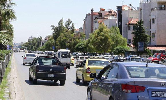 In this May 18, 2014 photo shows, syrians drive their vehicles in the capital Damascus, Syria.