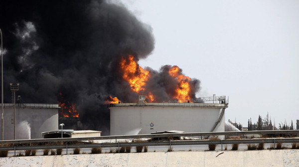 A general view shows fire burning at a fuel depot near the airport road in Tripoli July 29, 2014.