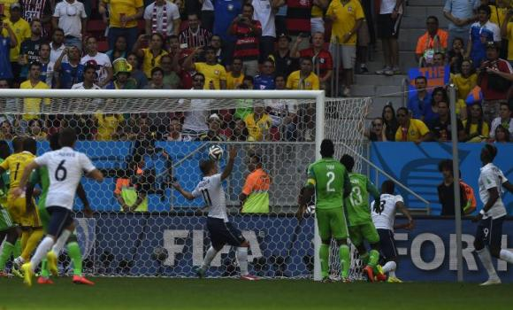 France's midfielder Paul Pogba, right, scores his team's first goal against Nigeria at Mane Garrincha National Stadium in Brasilia on Monday.