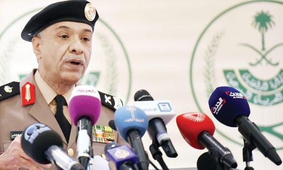 Interior Ministry's spokesman Gen. Mansur Al-Turki speaks to the press in Riyadh.