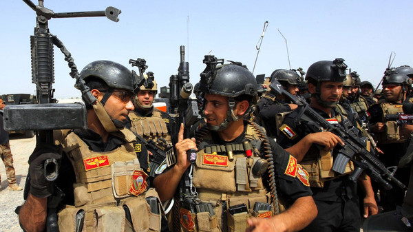 Members of the Iraqi Special Operations Forces (ISOF) prepare before going out on a patrol in the town of Jurf al-Sakhar, south of Baghdad, June 30, 2014.