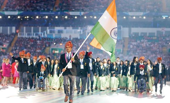 India's flag bearer Vijay Kumar leads his team.