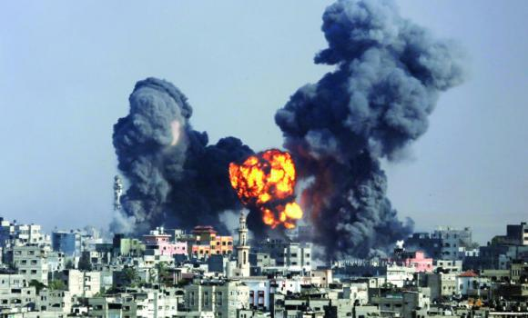 Smoke and fire rise following an Israeli strike in Gaza City on Tuesday. Strikes pummeled a wide range of locations along the coastal area.
