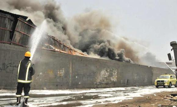 Firefighters battle a blaze in warehouses in Jeddah's Kilo 8 district on the Jeddah-Makkah Road on Saturday.