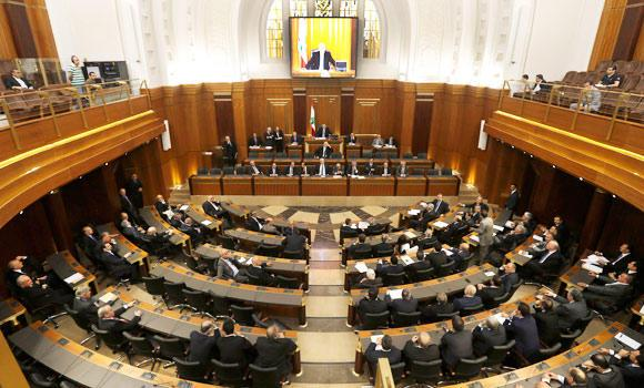 In this May 31, 2013, file photo, Lebanese lawmakers meet in the Lebanese Parliament during a session to debate whether to extend their term 17 months, in Beirut, Lebanon.