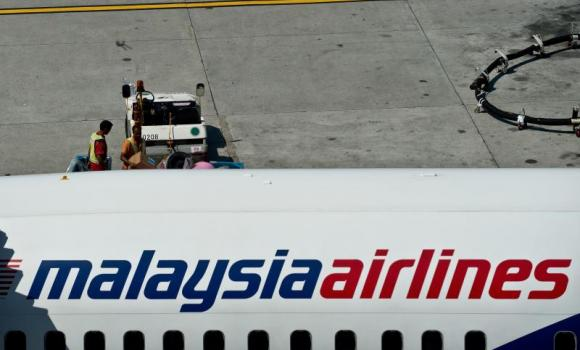 Groundstaff prepare a Malaysia Airlines plane for departure at the Kuala Lumpur International Airport in Sepang.