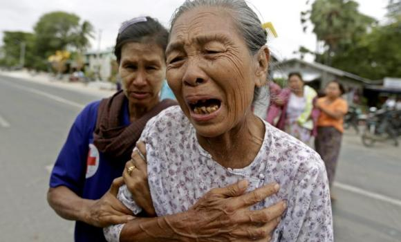 The grandmother of 36-year old Tun Tun, who was killed during clashes in Mandalay, cries at the funeral services in Mandalay, Myanmar.