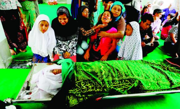 Relatives of a man who was killed in recent riots cry near his body at a mosque in Mandalay, Myanmar, on Thursday.