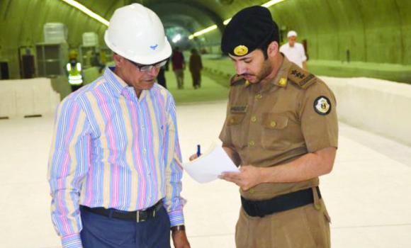 A police officer talks to an engineer at the new pedestrian tunnel in Makkah.