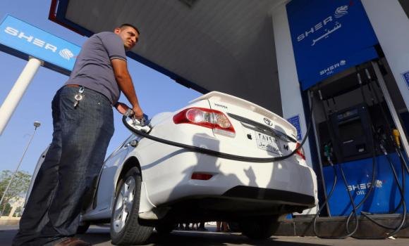 A man pumps gasoline into his car in Irbil, Iraq.