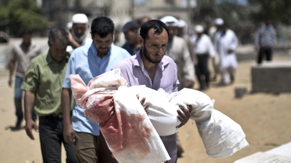 Palestinian mourners carry the body of five-year-old boy Abdallah Abu Ghazal during his funeral in the northern Gaza town of Beit Lahiya on July 10, 2014.