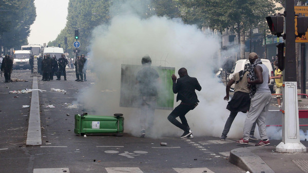 A Reuters photographer said demonstrators in northern Paris launched projectiles at riot police.