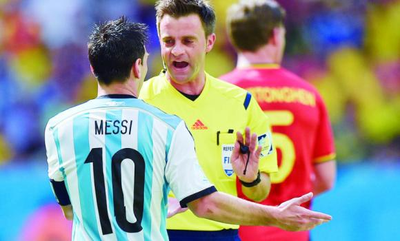 Referee Nicola Rizzoli of Italy speaks with Argentina's Lionel Messi during the World Cup quarterfinal soccer match between Argentina and Belgium in Brasilia, Brazil.