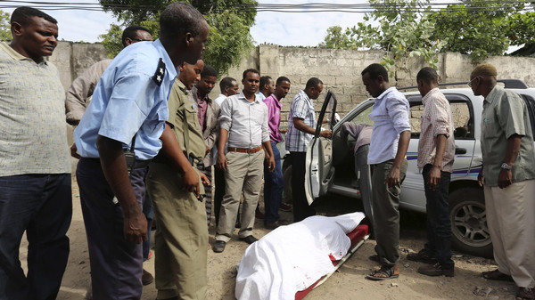 The body of Somali member of parliament Saado Ali Warsame lies next to a vehicle in Mogadishu July 23, 2014.