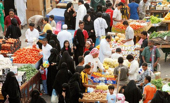 Saudis-and-expatriates-buy-vegetables-in-a-market-in-Jeddah