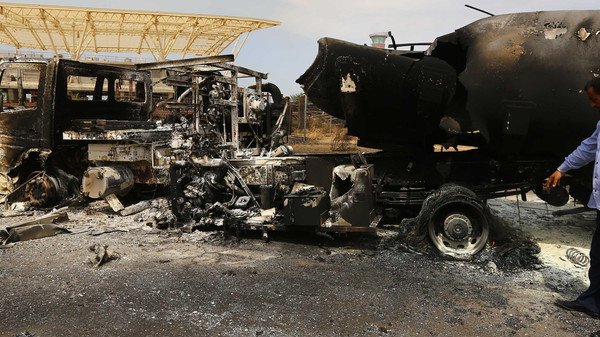 The wreckage of a truck and an airplane are seen at Tripoli international airport in the Libyan capital on July 14, 2014.