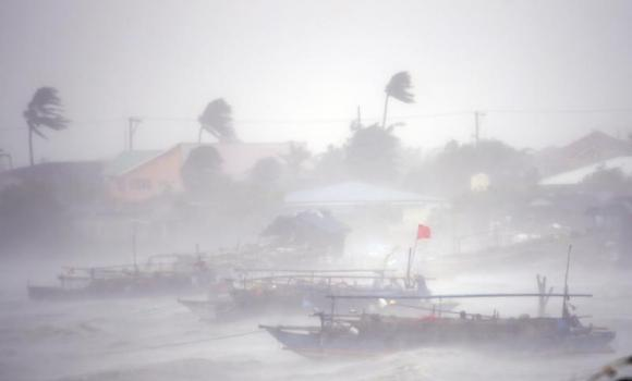 Fishing boats are pictured amid heavy winds and rain brought by Typhoon Rammasun (locally named Glenda) as it hit the town of Imus, Cavite southwest of Manila, on Wednesday.