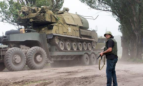 Ukrainian government forces maneuver antiaircraft missile launchers Buk as they are transported north-west from Slavyansk, eastern Ukraine Friday.