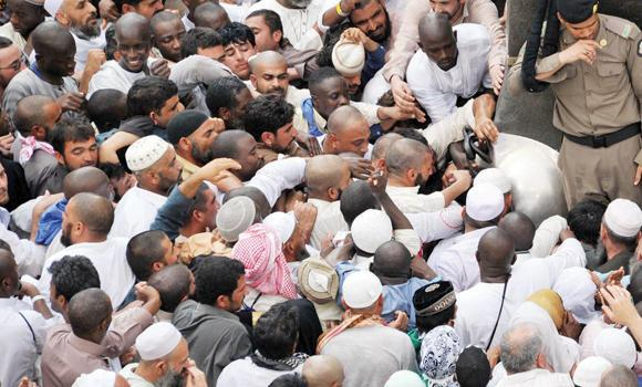 Worshippers try to reach Al-Hijr Al-Aswad, or the Black Stone, in the Grand Mosque in Makkah on Monday.