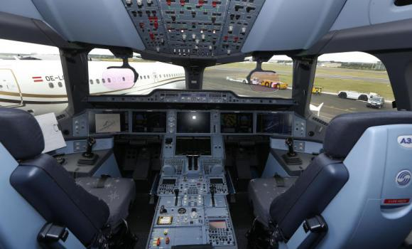 The cockpit of an Airbus A350 XWB is seen as it stands on display during Farnborough International Air Show in England.