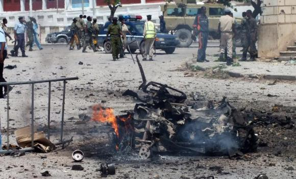 In this July 5, 2014, file photo, the remains of a car bomb burn after it exploded outside the Somali parliament building in Mogadishu. Al-Qaeda-linked Shabab rebels on Tuesday attacked the presidential palace and were evicted by government troops later in the day.