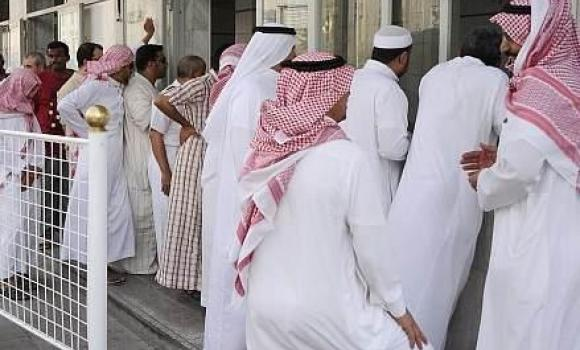 Customers stand in queues to buy famous foul dish in Jeddah.