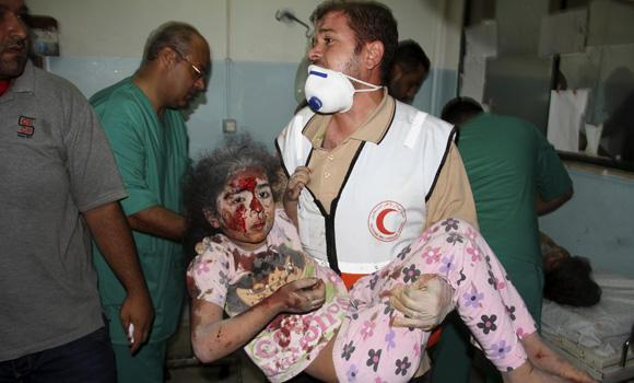 A Palestinian medic carries a wounded girl to a treatment room of Nasser hospital, following an Israeli airstrike at their family house in Khan Younis in the southern Gaza Strip on Wednesday.