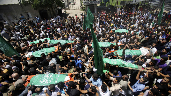 Mourners carry the bodies of eight Palestinian members from al-Haj family, who medics said were killed in an early morning air strike that destroyed at least two homes, during their funeral in Khan Younis in the southern Gaza Strip July 10, 2014.