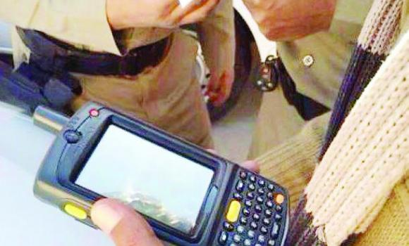 The new handheld devices used by traffic police officers to issue tickets instantly to violators.