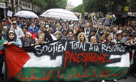 Thousands of pro-Palestinian demonstrators holding banners and chanting anti Israeli slogans walk in Paris on Sunday to protest against the Israeli army's bombings in the Gaza strip.