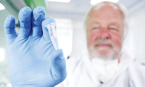 Oxford University genetics professor Bryan Sykes poses with a prepared DNA sample taken from hair from a Himalayan animal.