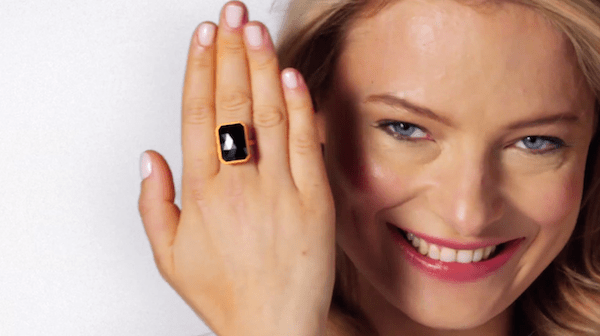 A model showcases a ring by Ringly, a wearable device that alerts users of notifications on their iOS and Android devices.
