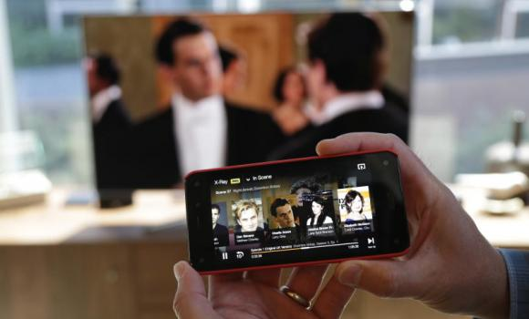 "A new feature lets the new Amazon Fire Phone send a movie or TV show wirelessly to a compatible television while the the phone serves as a ""second screen"" to display information about actors, locations, and scenes."