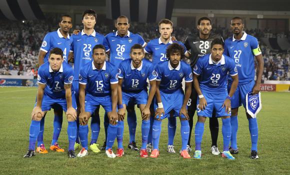 Al-Hilal's players pose before their AFC Champions League football match Qatari al-Sadd versus Saudi al-Hilal at the Sheik Jassim Bin Hamad Stadium on August 26, 2014 in Doha, Qatar.