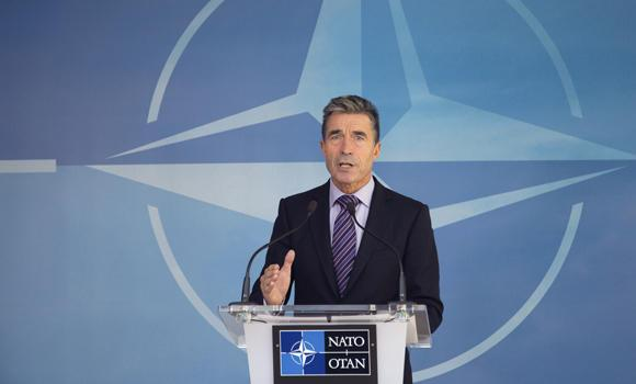 NATO Secretary General Anders Fogh Rasmussen speaks during a media conference at NATO headquarters in Brussels on Friday. NATO urged Russia to cease its military actions and take immediate and verifiable steps towards de-escalation of the crisis in Ukraine.