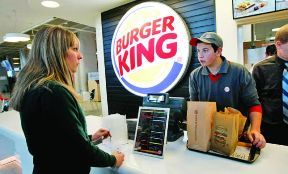 A customer purchases a meal at a Burger King restaurant in Marseille-Provence airport, in Marignane, France.