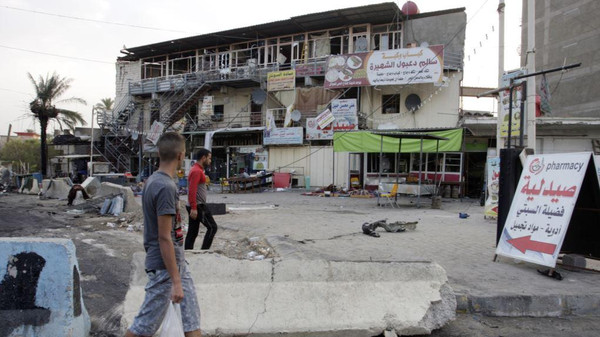 The site of a car bomb attack which killed 10 people in Baghdad on August 26.