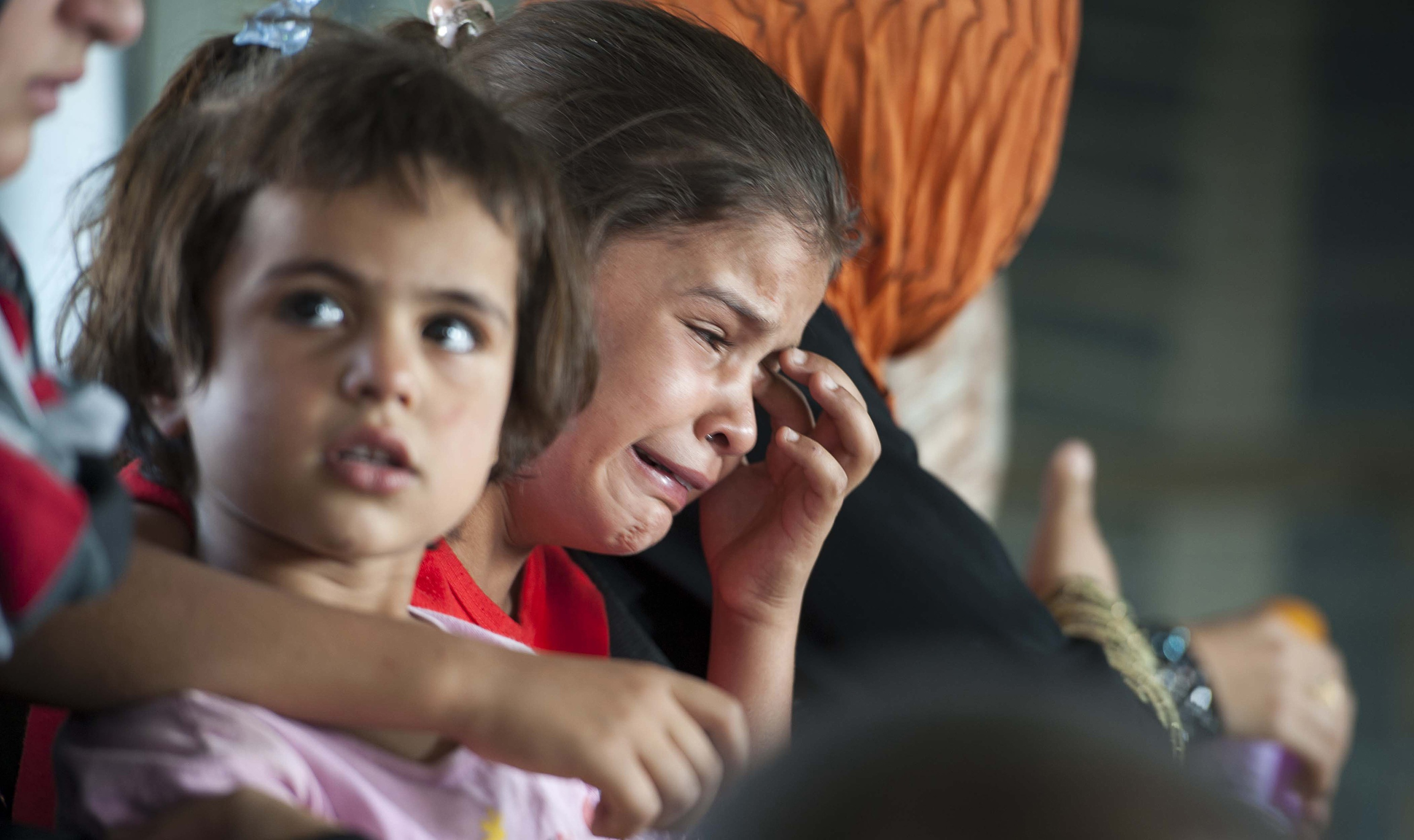 A child cries in a military helicopter after being evacuated by Iraqi forces from Amerli, north of Baghdad August 29, 2014.