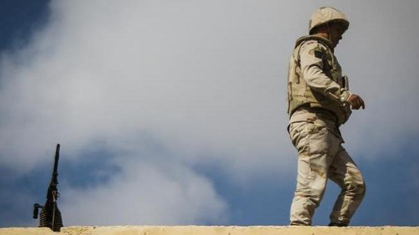 An Egyptian soldier stands guard along the Rafah border with Israel, Sinai July 19, 2014.