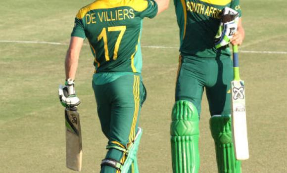 South African player Faf du Plessis, right, celebrates with AB de Villiers after scoring 100 runs during the cricket One Day International match against Australia in Harare Zimbabwe Wednesday.