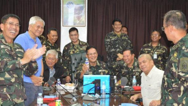 Top defense and military officials cheer at Camp Aguinaldo on Sunday, Aug. 31, after the successful repositioning of Filipino peacekeepers.