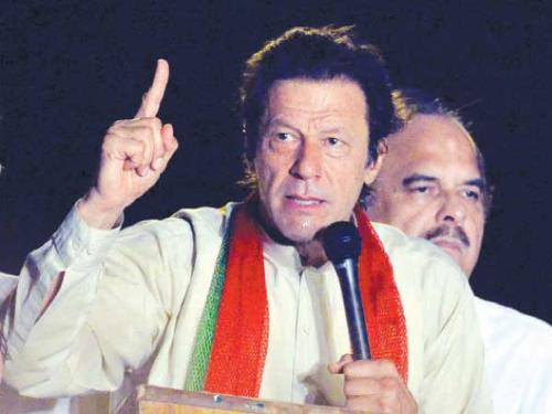 Pakistani opposition politician Imran Khan addresses his supporters during a protest march against the country's Pakistan Muslim League-Nawaz-led government in Pakistan's capital Islamabad on Monday.