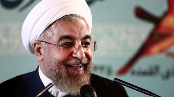 Iranian President Hassan Rouhani speaks at a press conference in Tehran on August 30, 2014.