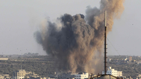 Smoke rises after an explosion in what witnesses said was an Israeli air strike in Gaza August 20, 2014.
