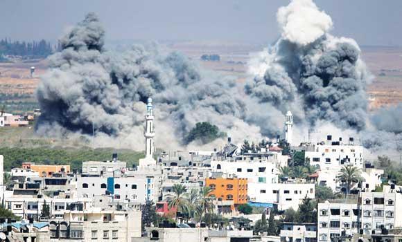 Smoke rises after an Israeli strike in Gaza on Thursday.