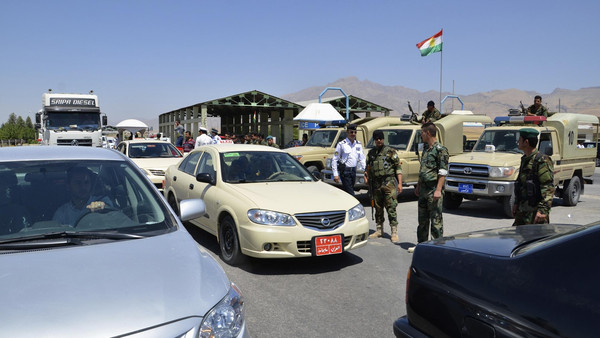 "Kurdish ""peshmerga"" troops stand guard during an intensive security deployment at the checkpoint at the entrance to Sulaimaniya province August 8, 2014."