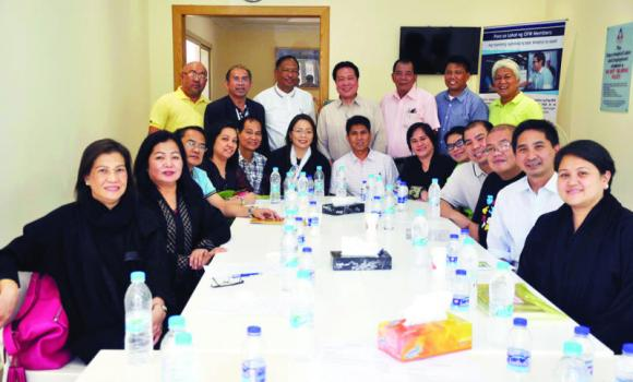 Labor Attache Resty Dela Fuente, third left, with community leaders and school representatives during the meeting.