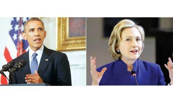 US President Barack Obama (L) and Hillary Rodham Clinton.